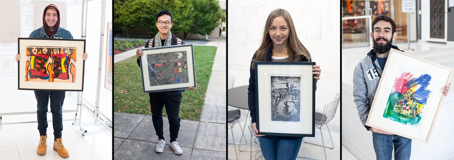 """Students with artwork from the """"Art to Live With"""" collection."""