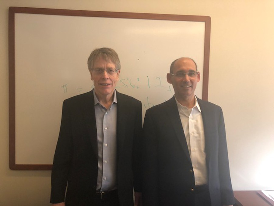 From left: Dr. Lars Hansen, a winner of the 2013 Nobel Prize in Economics, and his doctoral student Dr. Amir Yaron MA'1992, PhD'94, who was just nominated to lead the Bank of Israel.