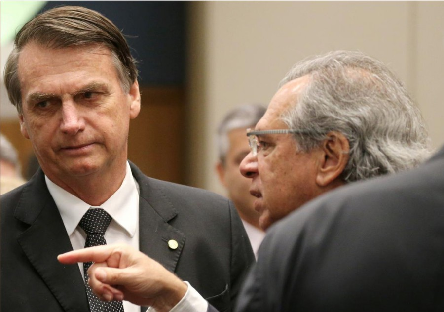 Paulo Guedes (right) speaks with Jair Bolsonaro, the frontrunner in Brazil's presidential election.
