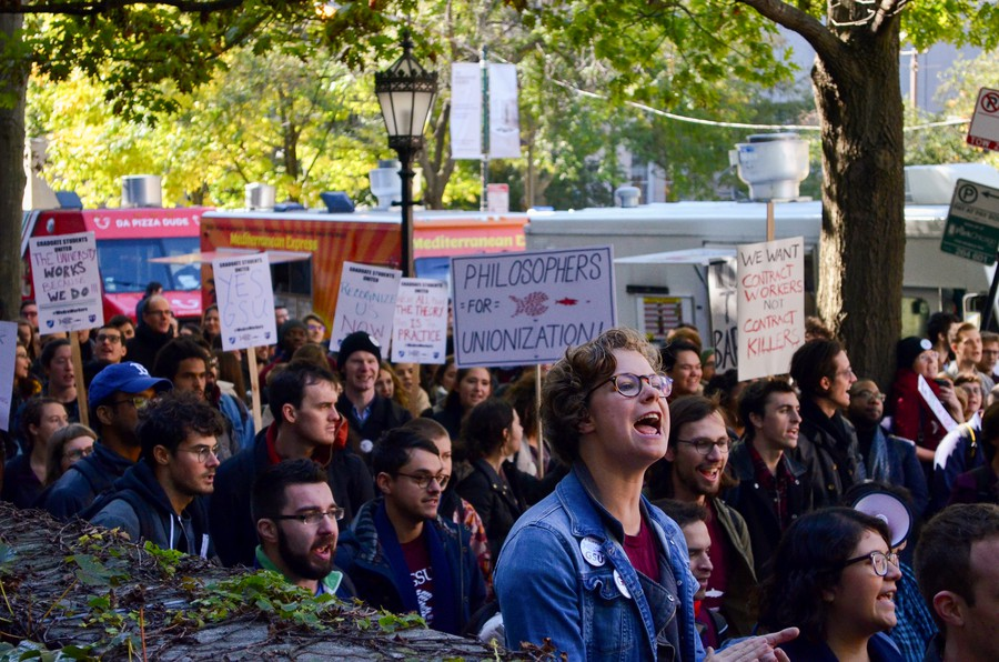 Graduate students chant at a walk out in October, 2018.