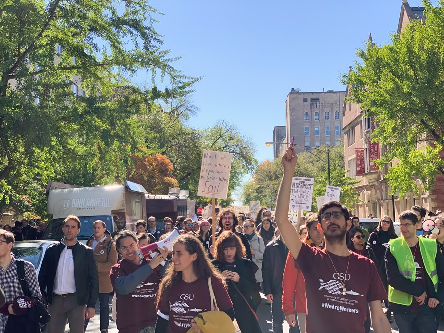 Demonstrators march through the street on South Ellis Avenue.