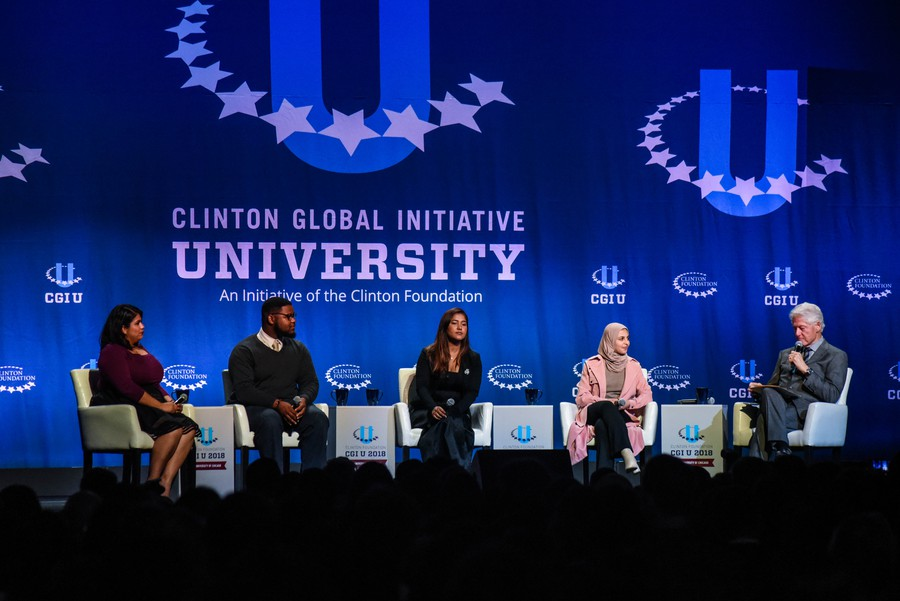 Former President Bill Clinton speaks with panelists at the 11th annual Clinton Global Initiative University.