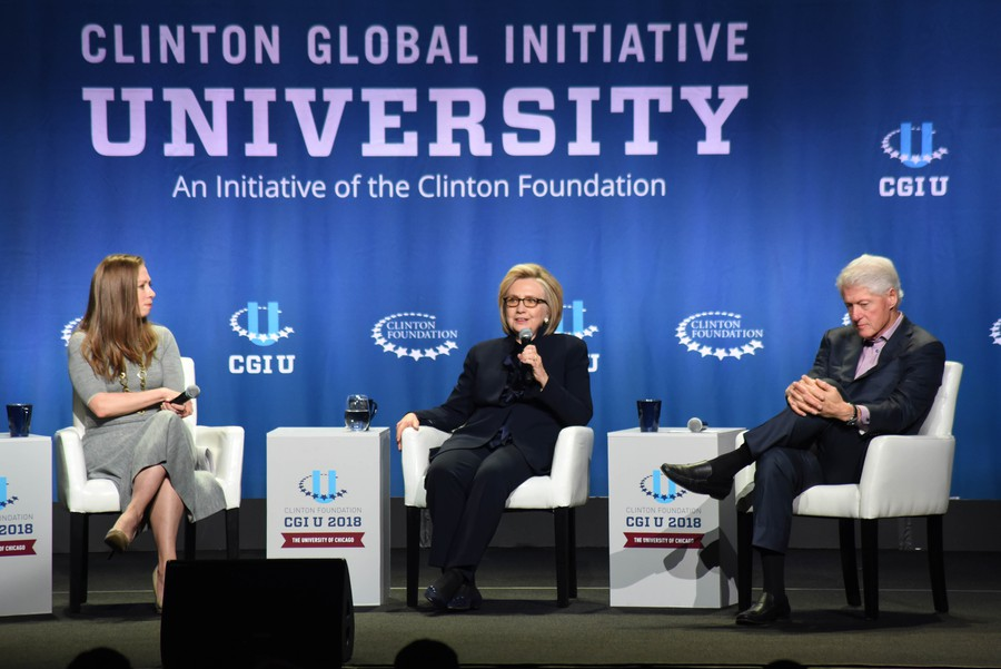 Former president Bill Clinton, former secretary of state Hillary Clinton, and Clinton Foundation Vice Chair Chelsea Clinton speak at the closing session of CGI U.