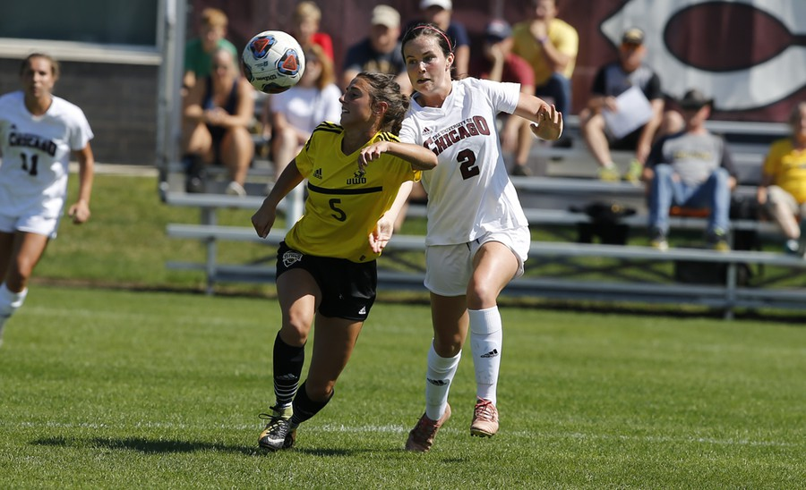 Third-year Hanna Watkins battles a defender for possession of the ball.