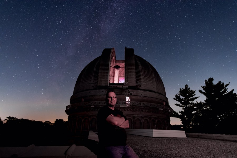 Dan Koehler stands in front of the observatory's main refractor telescope dome.