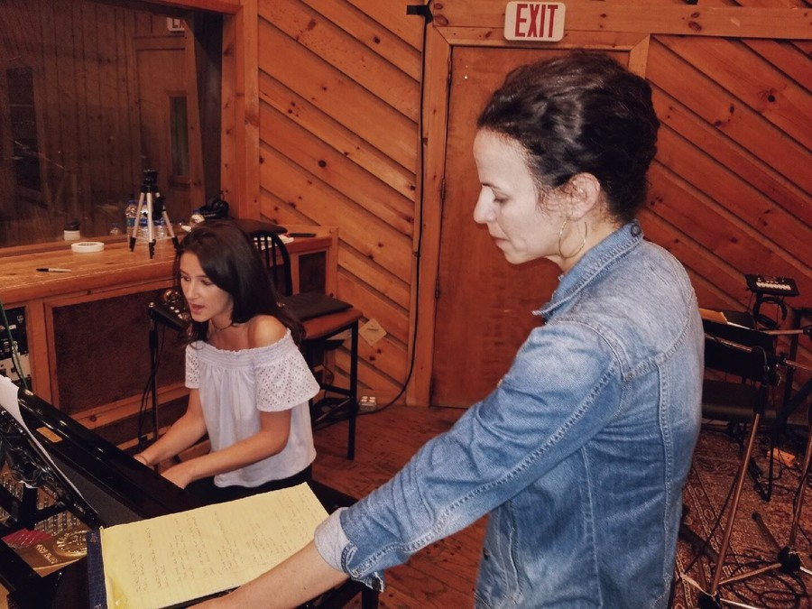 "Baxter records her song, ""Line in the Sand,"" with Hamilton star Mandy Gonzalez."