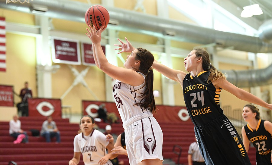 Fourth-year Jamie Kockenmeister delivers a layup in the final seconds of the game against Illinois Wesleyan University to win the game by just one point.
