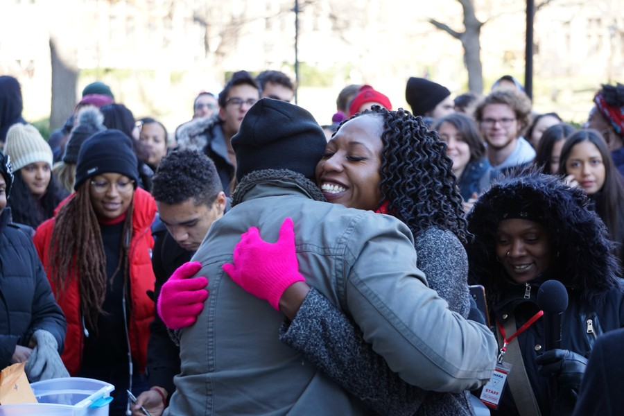 Enyia hugs an organizer on her campaign during the rally.