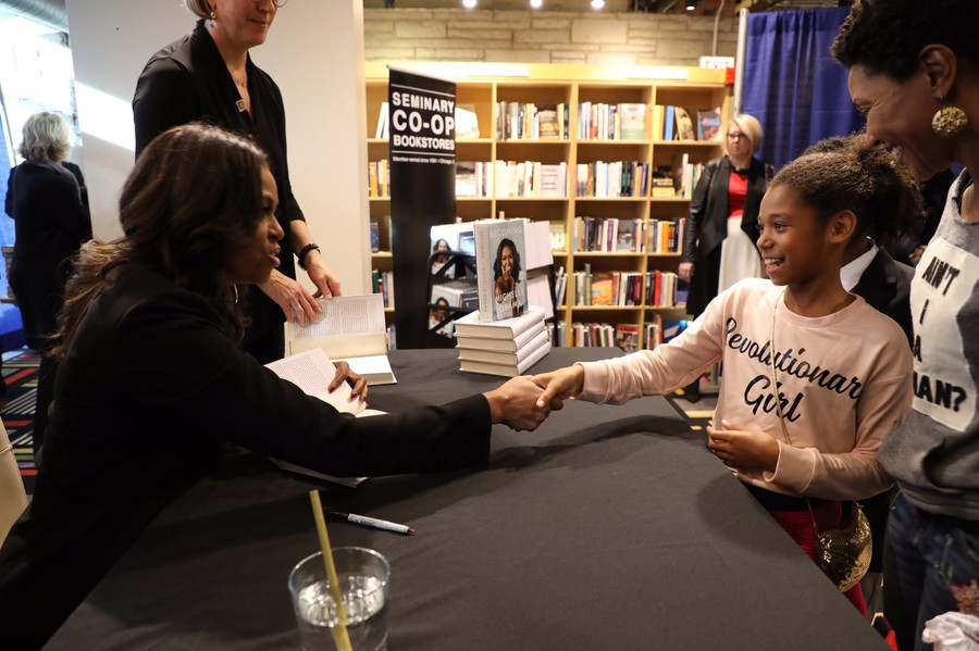 """Ms. Obama tweeted photo, with caption: """"It seems like yesterday that @BarackObama and I were taking our girls to @57thstreetbooks store. Today, I was there with a book of my own. Thanks to everyone who braved the cold and stopped by. #IAmBecoming"""""""