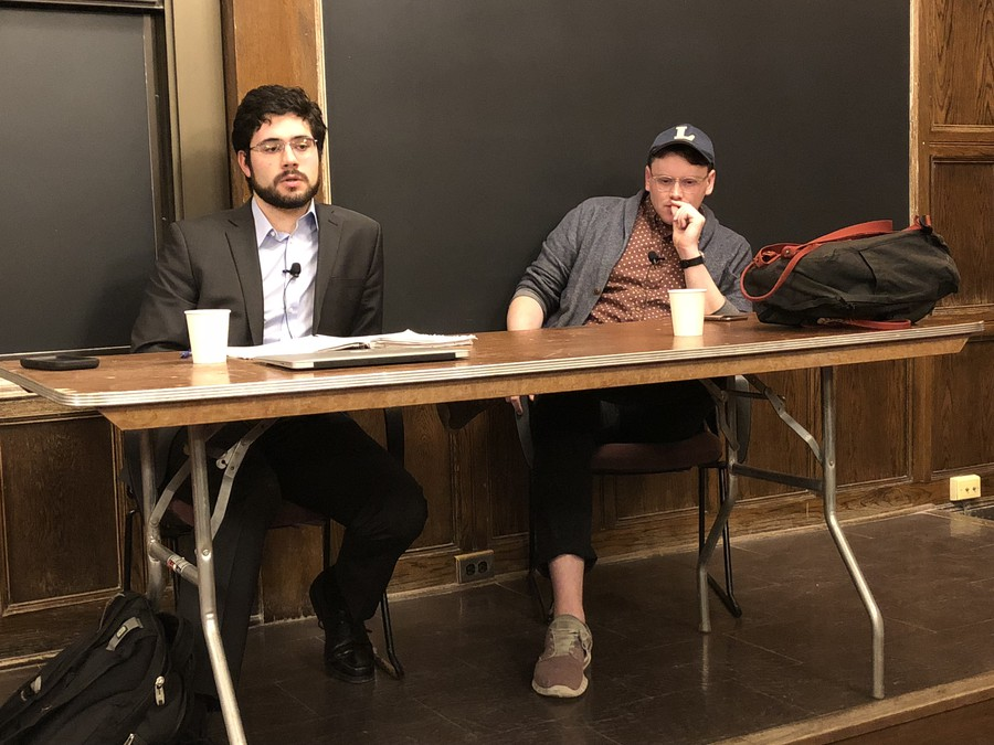 Third-year Eugene Miravete, left, debates Sean McElwee, right, on his proposal to abolish U.S. Immigration and Customs Enforcement (ICE).