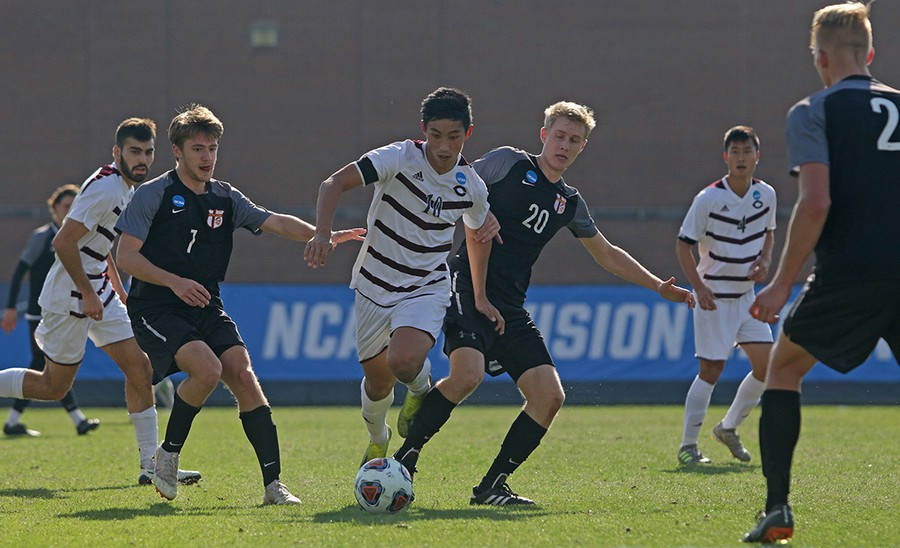 Fourth-year Matthew Koh battles a Calvin Knight player for possession.