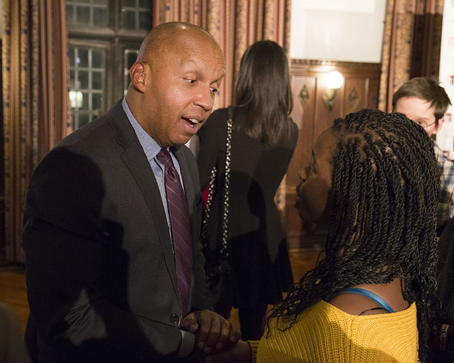 Equal Justice Initiative founder Bryan Stevenson chats with a student after his talk.