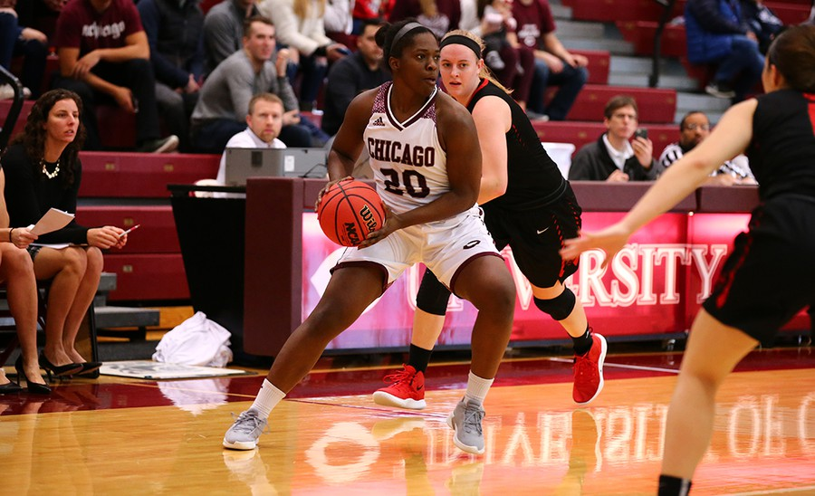 Fourth-year Olariche Obi looks to pass between Wash U opponents.