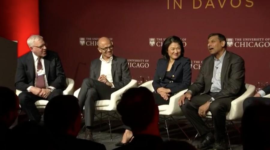 Panelists at Tuesday's forum in Davos. Left to right: trustee David Rubenstein (J.D. '73), Microsoft CEO Satya Nadella, SOHO CEO Xin Zhang, and Booth professor Raghuram Rajan.