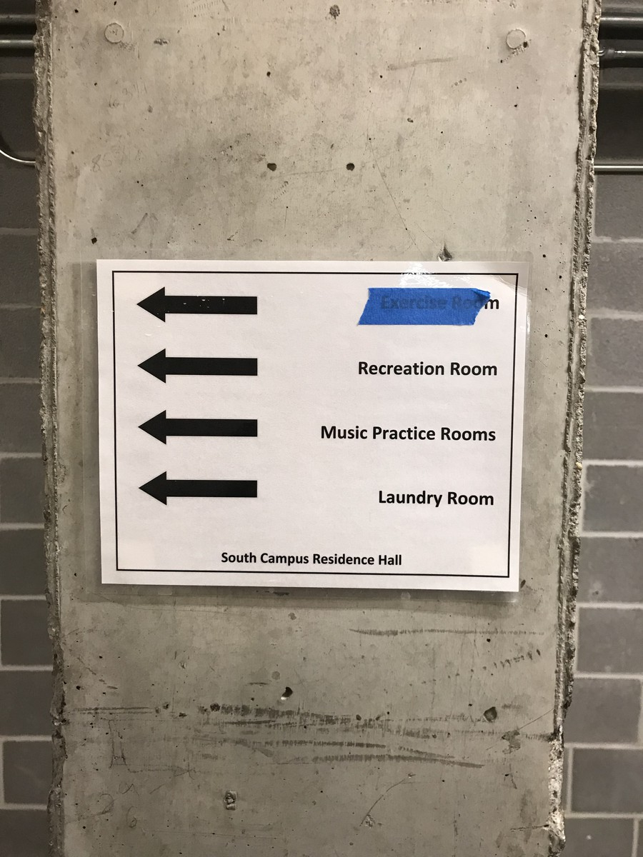 In South Campus Residence Hall, tape mysteriously covers the sign pointing to the Exercise Room.