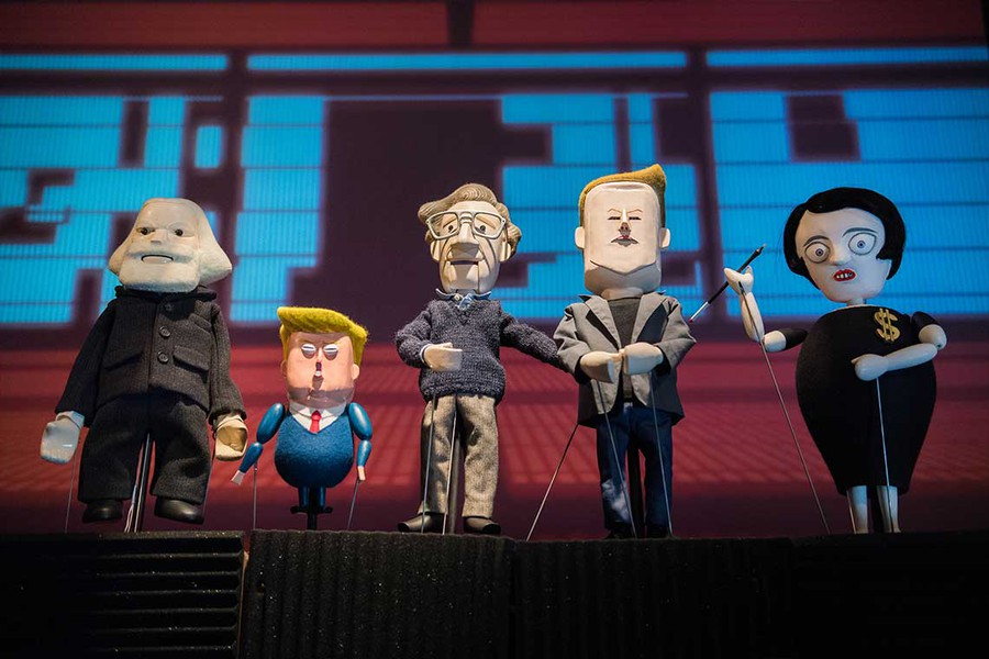 """Performed at the Logan Center for the Arts, """"Manufacturing Mischief"""" satirizes Noam Chomsky, Karl Marx, Elon Musk, and President Drumpf as puppets."""