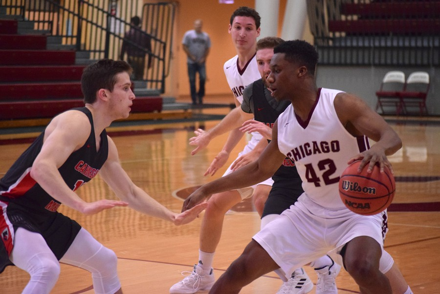 Fourth-year Justin Jackson dribbles around his CMU opponent.