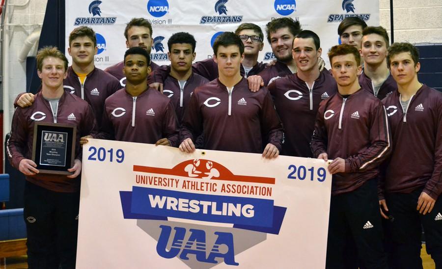 The UChicago wrestling team celebrates its championship victory.