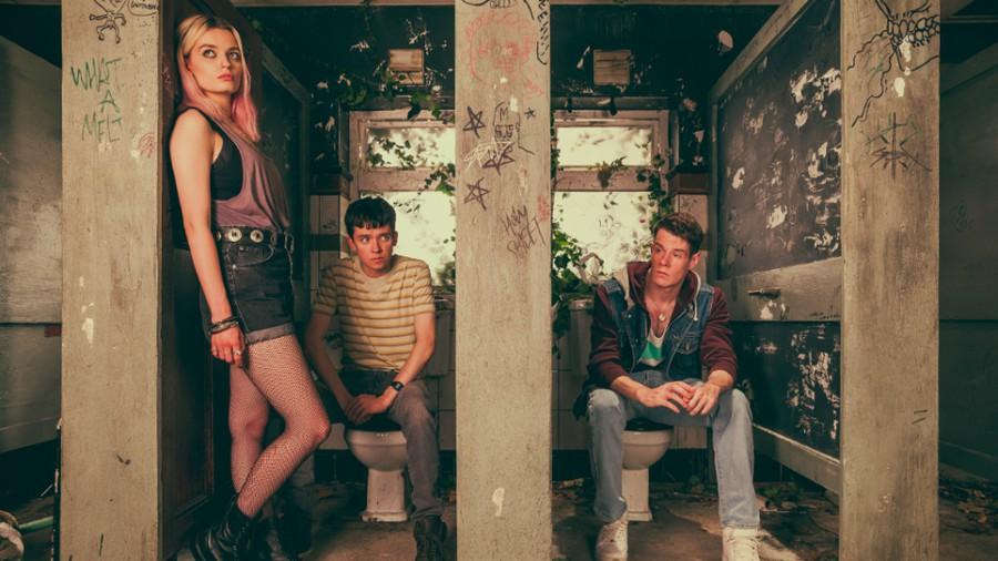 "Maeve (Emma Mackey), Otis (Asa Butterfield), and Adam (Connor Swindells) in ""Sex Education"""