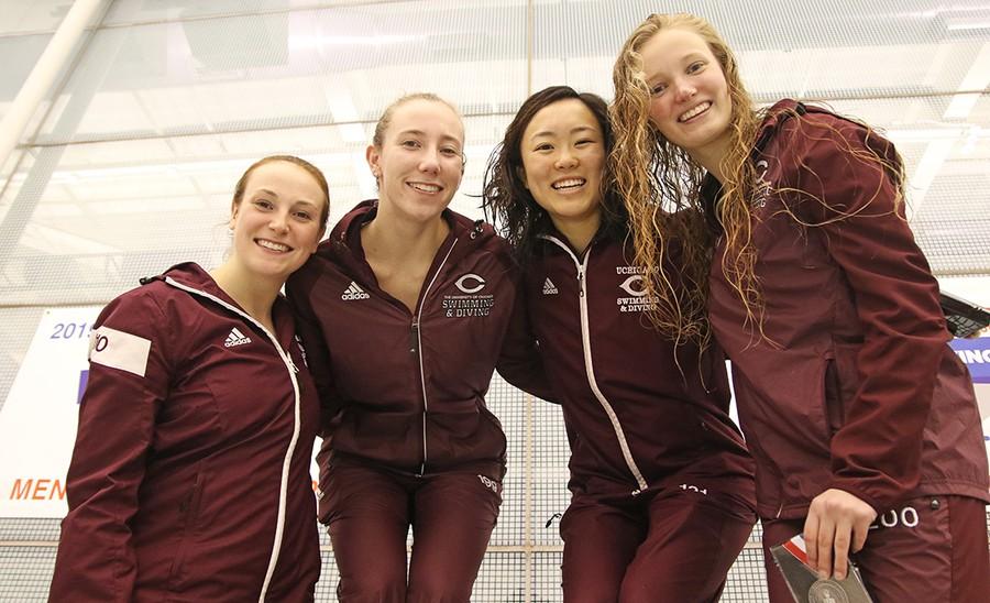 Divers Anna Girlich, Alice Saparov, Agnes Lo, and Elizabeth Cron smile atop the podium.