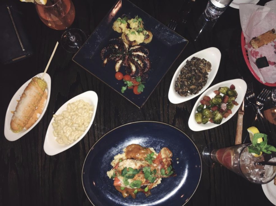 Clockwise from top: Grilled Spanish Pulpo, Sauteed Mushrooms, Brussel Sprouts, Maine Lobster, Truffle Mac and Cheese, Elote.