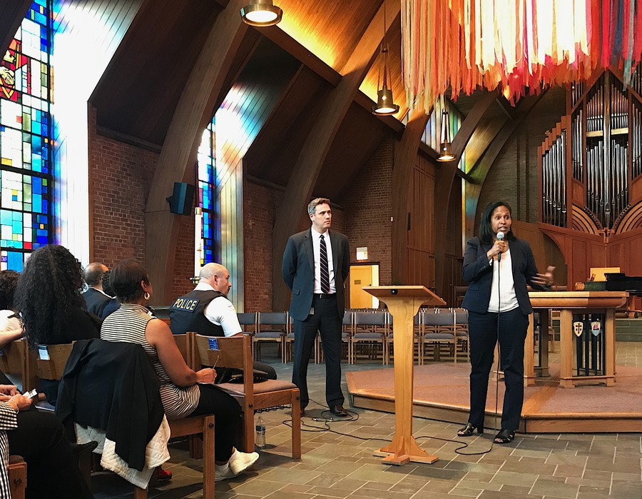 Fourth Ward Alderman Sophia King, right, speaks with Eric Heath, UChicago's Associate Vice President of Safety & Security, at a community meeting last May