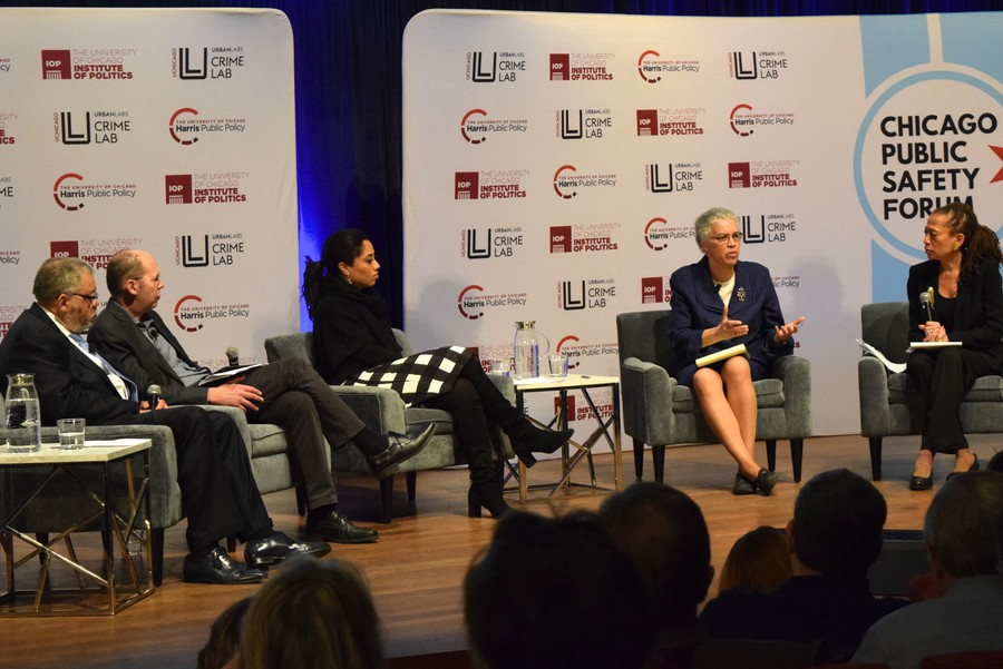 Candidate Toni Preckwinkle speaks with moderator Laura Washington and a panel of experts at Wednesday's forum, held in the Logan Center.