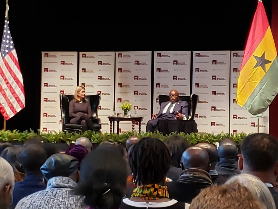 Ghana President Nana Akufo-Addo answering questions from attendees, sitting alongside IOP executive director Gretchen Crosby-Sims.