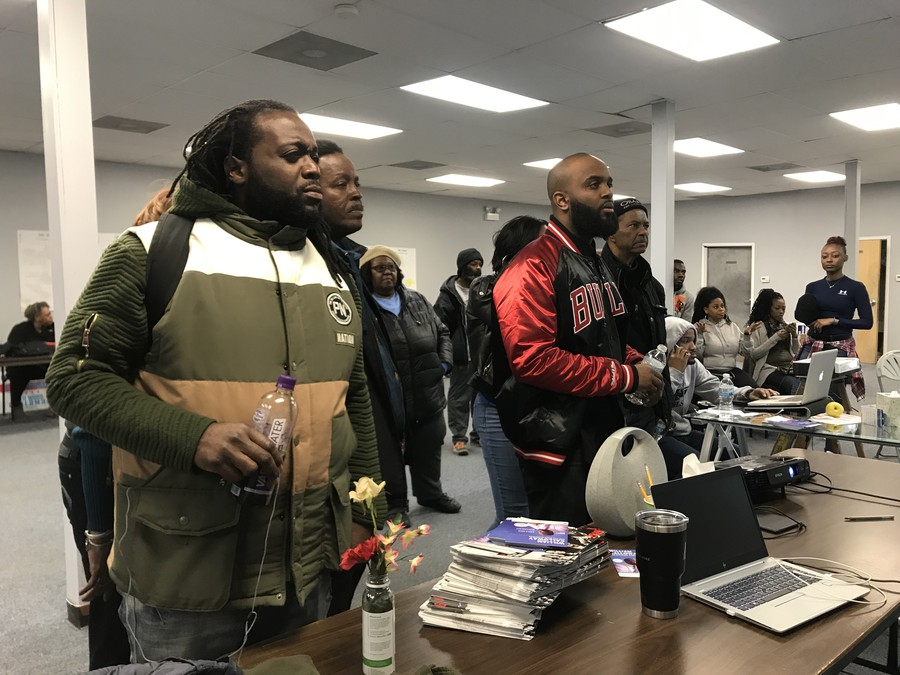 Fifth Ward aldermanic candidate William Calloway watches run-off election night news coverage with supporters at campaign party on Tuesday.