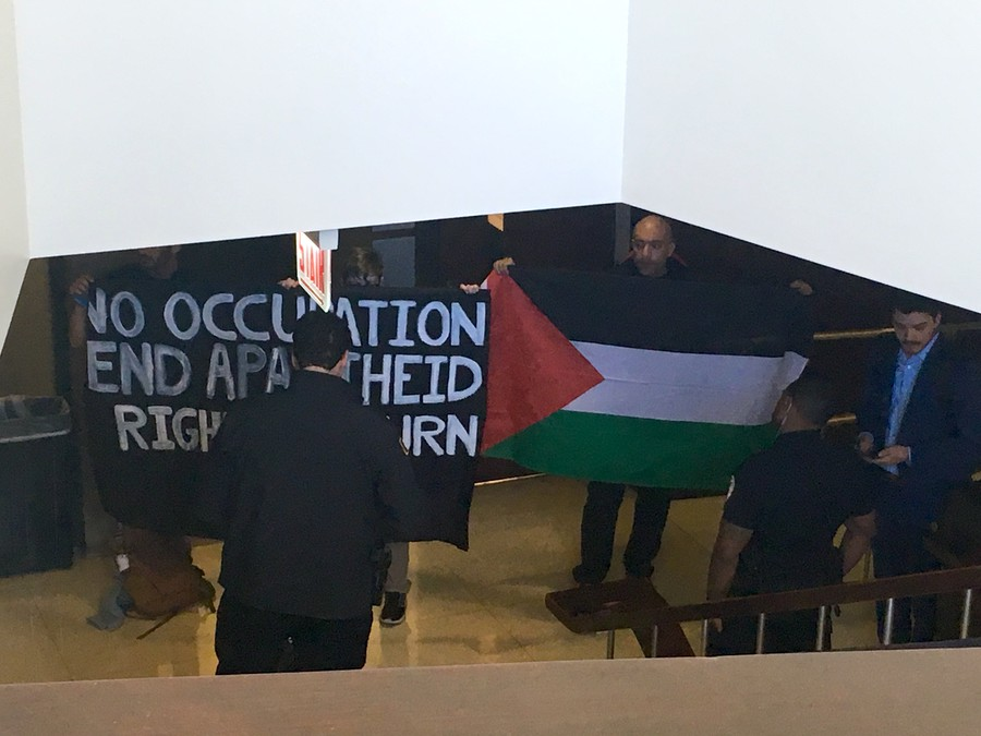 The protestors standing outside the talk