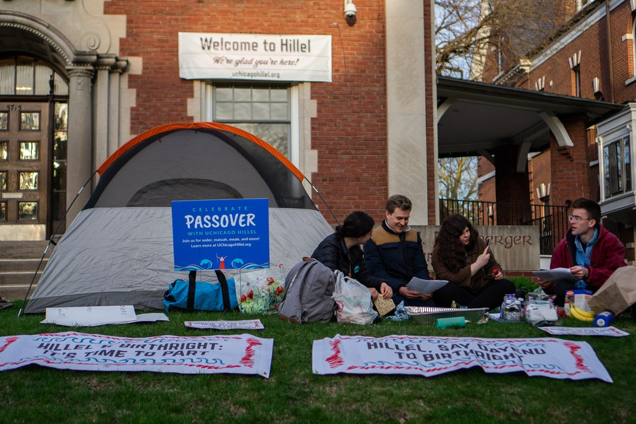 IfNotNow protestors holding a sit-in outside UChicago Hillel.