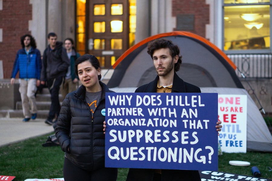 Protesters with UChicago IfNotNow sit in outside UChicago Hillel to protest Birthright.