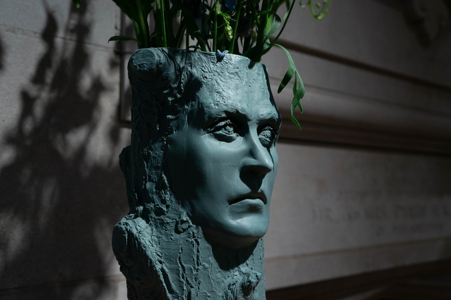 "Wittgenstein's face emerges from a tree at the Neubauer Collegium's ""HUTOPIA."""