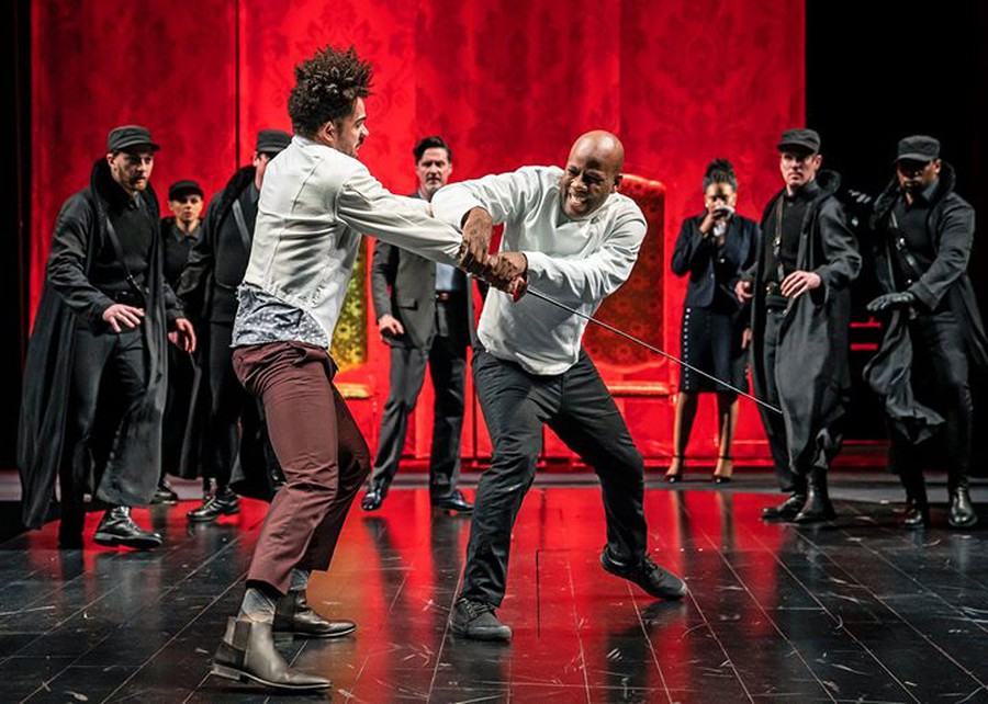 Hamlet (Maurice Jones) and Laertes (Paul Deo, Jr.) duke it out in the climactic finale of Chicago Shakespeare Theater's production of HAMLET, directed by Barbara Gaines.