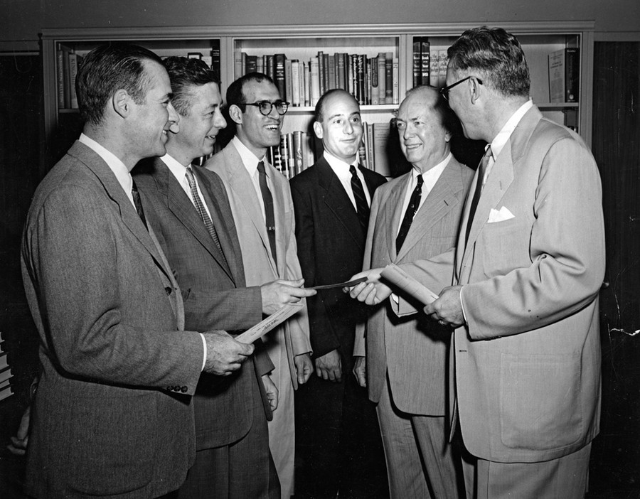 University of Chicago chancellor Lawrence A. Kimpton (far right) presents the Quantrell Award to members of the university faculty. Ernest E. Quantrell, university alumnus and trustee who founded the award, is second from right.