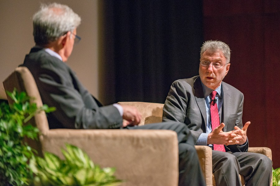 Martin Baron of the Washington Post talks with Professor Geoffrey Stone at an IOP event.