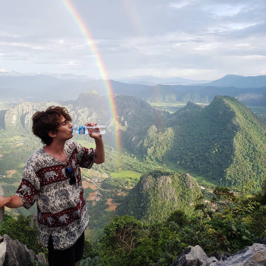 """Fausett in Laos, where he died. This is the last picture he sent his family, his father Bret Fausett said. """"He was reminding us that he was staying hydrated—but beside a double rainbow."""""""
