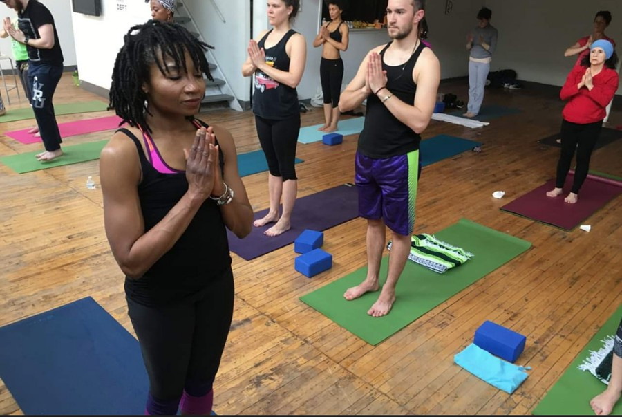 Sidra Newman teaching a yoga class