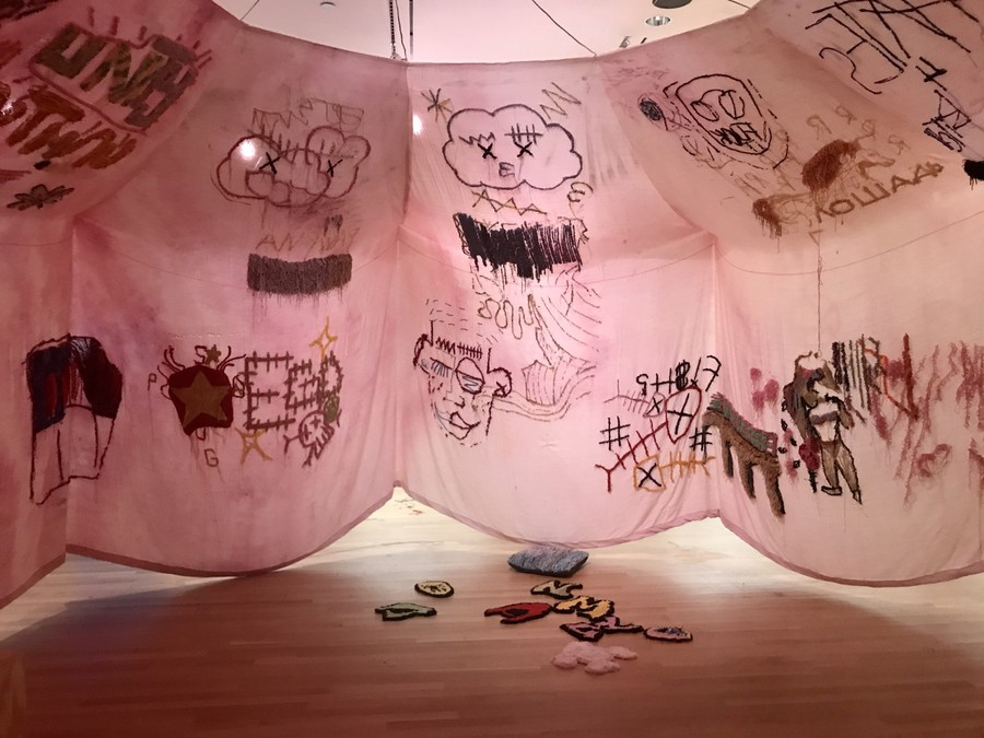 """See """"The Tent,"""" on display in the Logan Center exhibition space as part of """"Tufting Gun Tapestries,"""" through October 27th."""