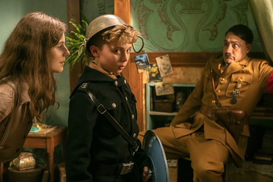 """Thomasin McKenzie, Roman Griffin Davis and Taika Waititi in """"Jojo Rabbit,"""" written and directed by Waititi."""