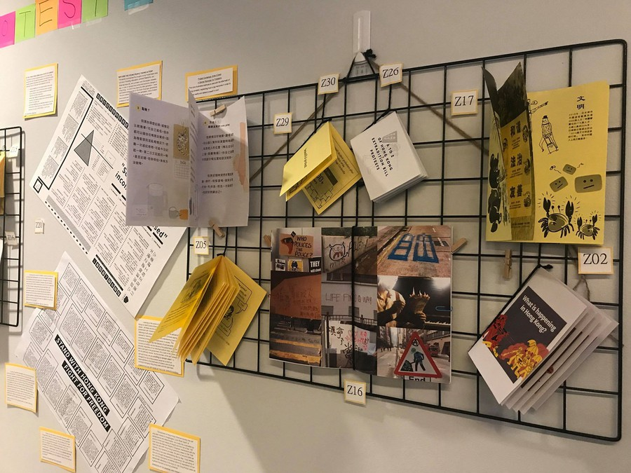 """Zines hang at the Center for the Study of Race, Politics, and Culture as part of """"THE ART OF PROTEST: Hong Kong Movement Zines 抗議之藝術:香港小冊子,"""" on display through Dec 14th"""