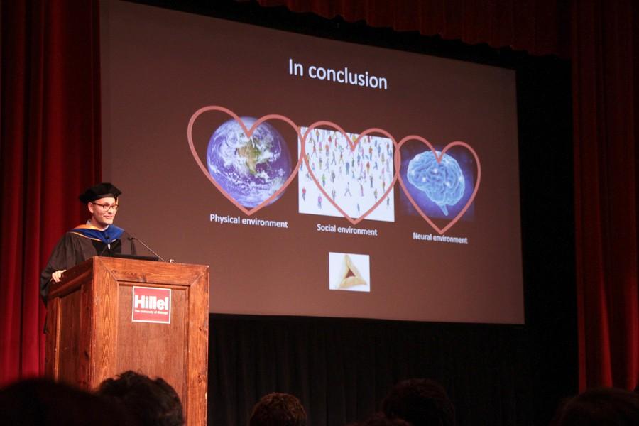 Psychology professor Marc Berman onstage at Hillel's 73rd Annual Latke-Hamantash Debate.