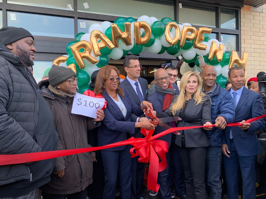 Fifth Ward Alderman Leslie Hairston cut the ribbon of South Shore's new Shop and Save on December 11, 2019, joined by owners Eva and Cezary Jakubowski and Chicago's Planning and Development Director Maurice Cox.