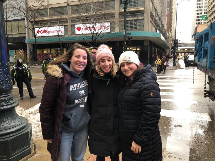 UChicago undergraduates Zoe Benjamin, Anya Edelstein, and Megan Bonnise at the 2020 Chicago Women's March