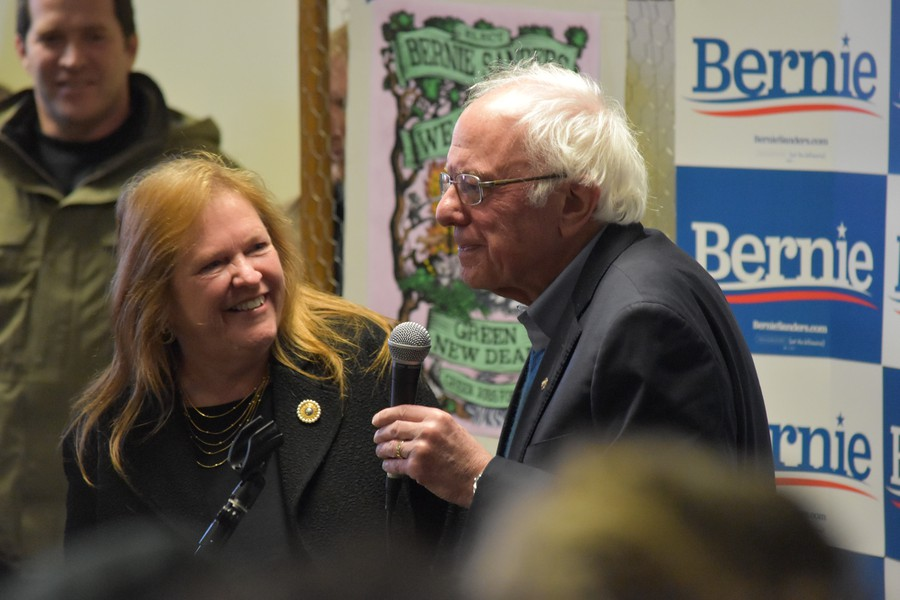 Senator Sanders takes the mic in Iowa City beside his wife, Jane.