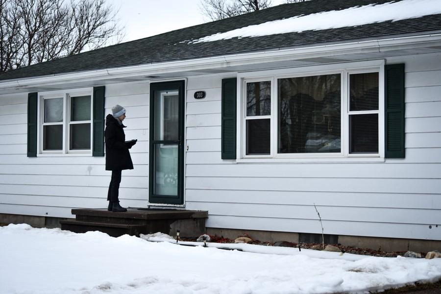 A UChicago for Bernie volunteer knocks a door in Iowa City.