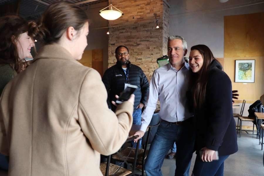 Olivia Ortiz, a Benedictine College student, takes a photo with long-shot Republican challenger Joe Walsh.