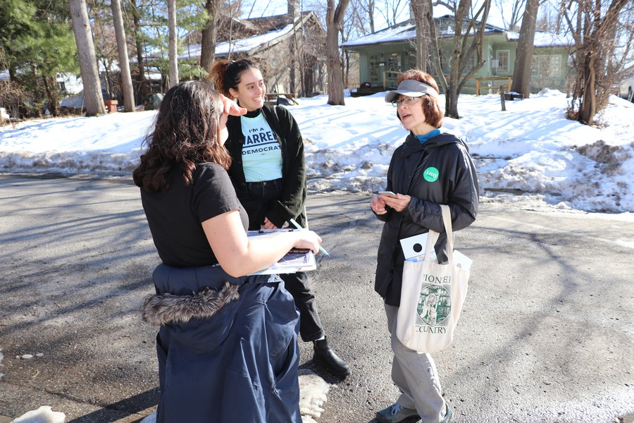 UChicago for Warren volunteers run into a volunteer for Amy Klobuchar out canvassing in Des Moines.