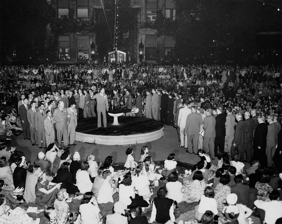 Fraternities and women's social club members gather on campus for the 1949 IF Sing.