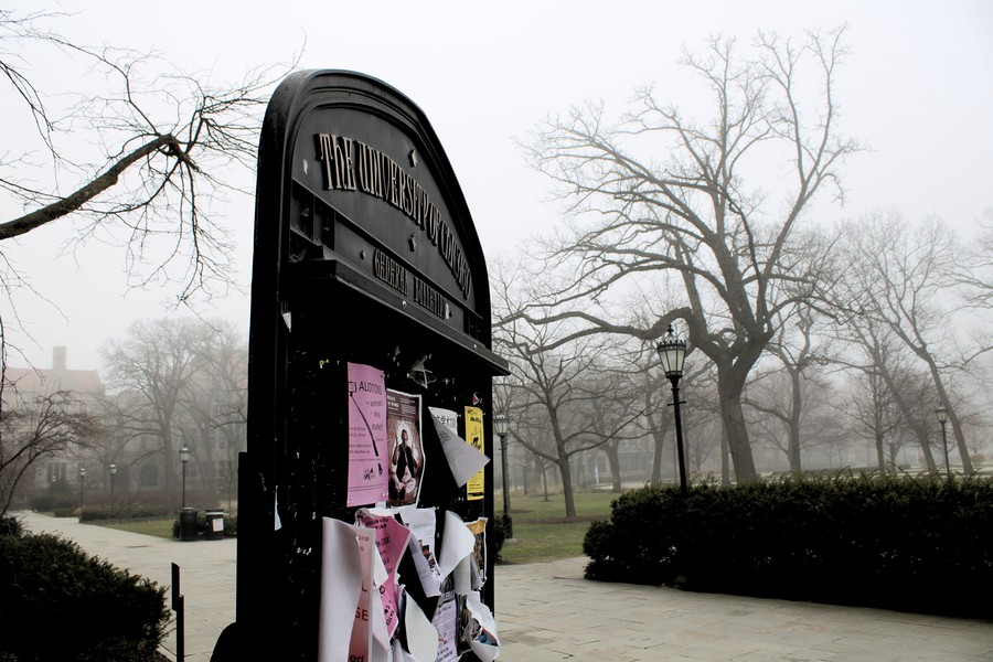 A bulletin board outside of Cobb Hall, on a misty day during spring break 2020, after many students had already left campus.